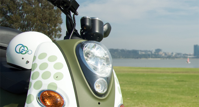 Geniux Go (GGo) scooter with Perth CBD in the background.